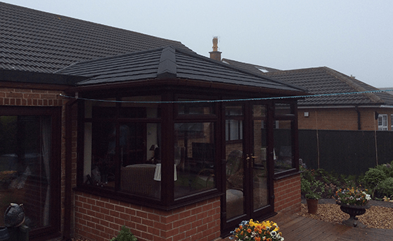 A brown conservatory on a bungalow